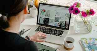 Market a business. Photo of person using laptop for graphic designs