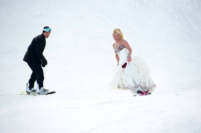 bride and groom snowboarding