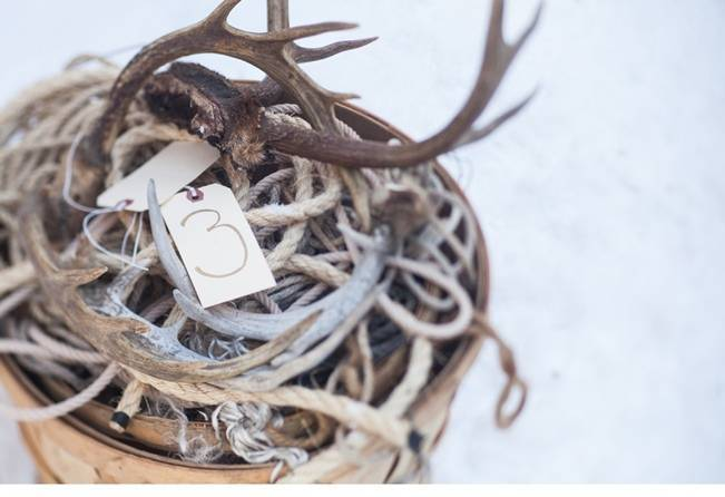 winter wedding table numbers antlers
