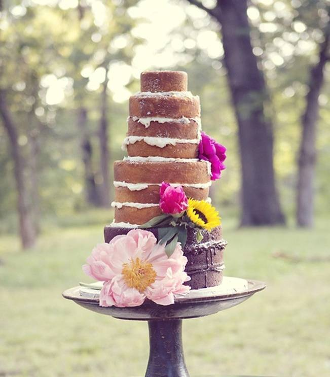 unfrosted rustic cake with flowers