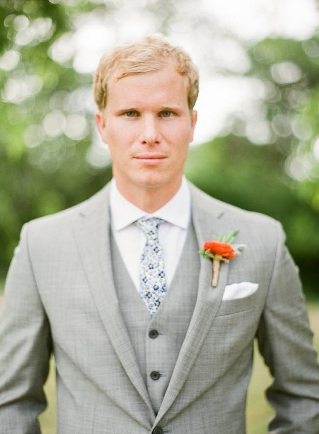 grey groom suit with orange boutonniere