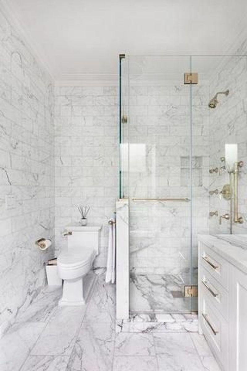 Amazing White Tile Bathroom Design Ideas Looks Elegant 27