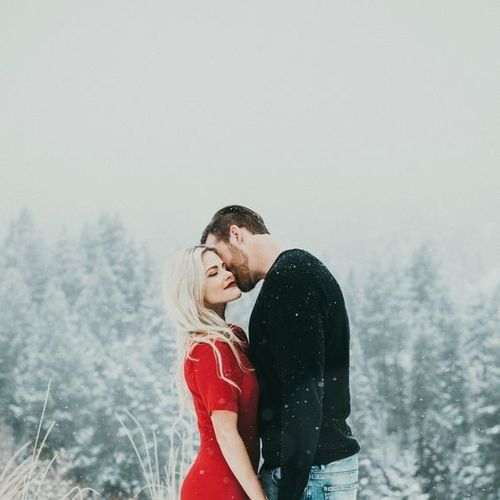 beautiful couple in love hugging in winter