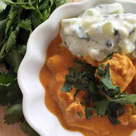 Butter chicken with cucumber raita.