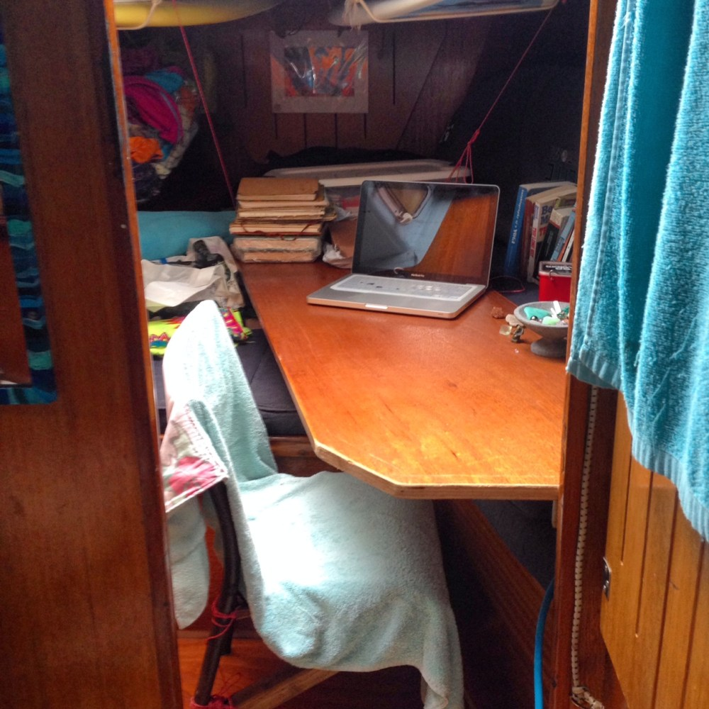 The forward cabin writing station made from the old door to the head (bathroom).