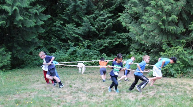 Campers Playing Three-Sided Tug of War