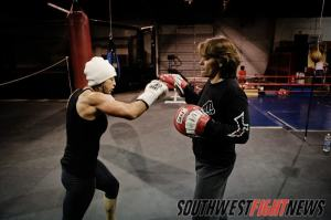 New Mexico is rich in the women's combat sports history and you need to look no further then FIT NHB Coach Arlene Vaughn (holding mitts) and Boxer turned MMA fighter Monica Lovato (punching) to start learning your New Mexico WMMA history.