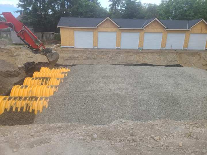 picture of a storm infiltration gallery system in front of garages at a multi-family housing new development.