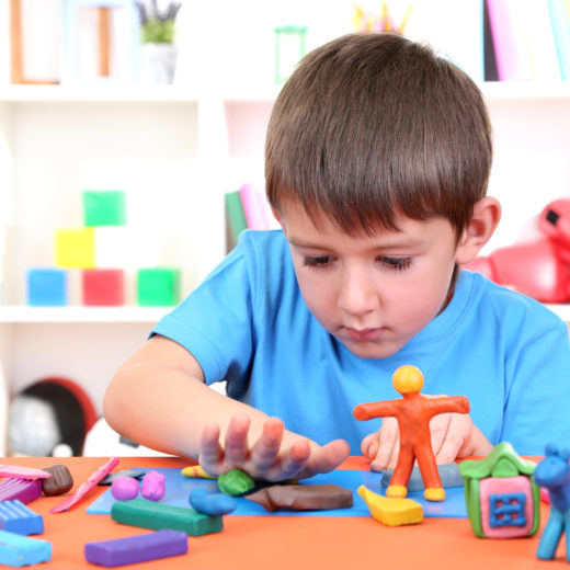 boy playing occupational therapy