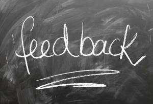 Chalk board that says feed back - improve your business