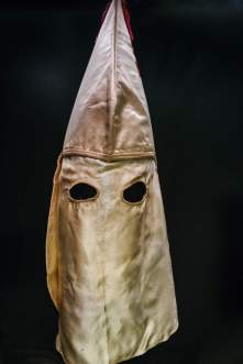 KKK HOOD - Powerful objects The collection includes potent artifacts, including a Ku Klux Klan hood and stereotypical representations of black Americans. (Credit: All Artifacts from the collection of the Smithsonian National Museum of African American History and Culture / Photo via New York Times)