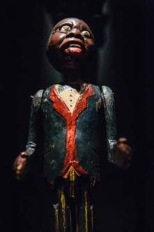 MINSTREL RACISM - Powerful objects The collection includes potent artifacts, including a Ku Klux Klan hood and stereotypical representations of black Americans. (Credit: All Artifacts from the collection of the Smithsonian National Museum of African American History and Culture / Photo via New York Times)