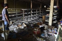 View of damage in a supermarket in Valencia, Carabobo State, on May 5, 2017, the day after anti-government protesters looted stores, set fire to cars and clashed with police, leaving at least five people injured, and one dead after being hit in the head by a projectile . (Photo: Ronaldo Schemidt / AFP / Getty)
