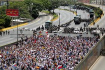 Demonstrators gather in front of the police as they attend a women's march to protest against President Nicolas Maduro's government in Caracas on May 6, 2017. (Photo: Christian Veron / Reuters)