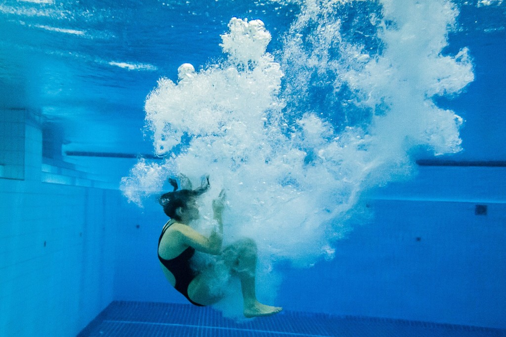 A diver entering the water from the 3 meter springboard.