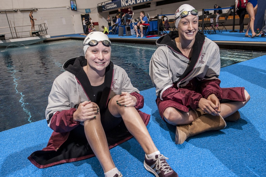 Ashley McGregor and Breeja Larson relax before their 100 breaststroke heats.