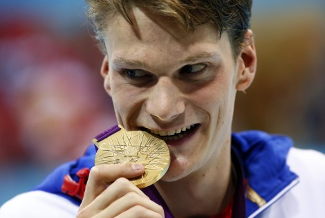Jul 30, 2012; London, United Kingdom; Yannick Agnel (FRA) poses with his gold medal after winning the men's 200m freestyle finals during the London 2012 Olympic Games at Aquatics Centre. Mandatory Credit: Rob Schumacher-USA TODAY Sports
