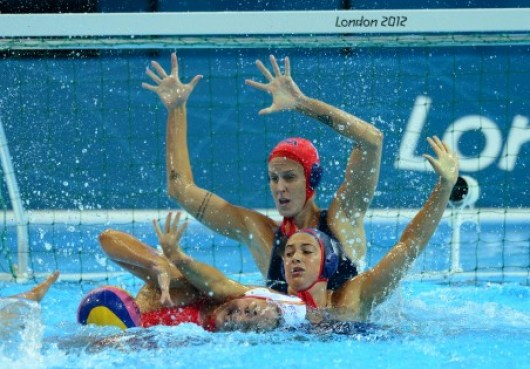 Aug 1, 2012; London, United Kingdom; USA centre back (6) Maggie Steffens and goal keeper (1) Betsey Armstrong defend the goal against Spain during a preliminary round of the London 2012 Olympic Games at Water Polo Arena. The match ended in a tie. Mandatory Credit: Mark J. Rebilas-USA TODAY Sports