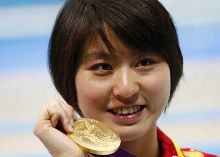 Aug 1, 2012; London, United Kingdom; Liuyang Jiao (CHN) celebrates with her gold medal after winning the women's 200m butterfly finals during the London 2012 Olympic Games at Aquatics Centre. Mandatory Credit: Rob Schumacher-USA TODAY Sports