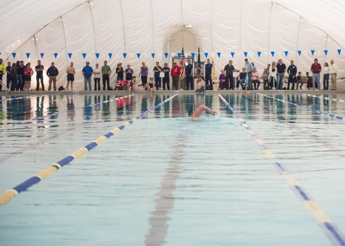 Lt. Shannon Scaff, an instructor at the Coast Guard Maritime Law Enforcement Academy in Charleston, S.C., takes the first lap of a long distance swim he dedicated to a fallen Coast Guard aircrew, Feb. 27, 2015. Scaff undertook the challenge of swimming in a local Charleston pool for 24 hours to bring awareness and support to the families of fallen military members. (U.S. Coast Guard photo by Petty Officer 1st Class Stephen Lehmann)