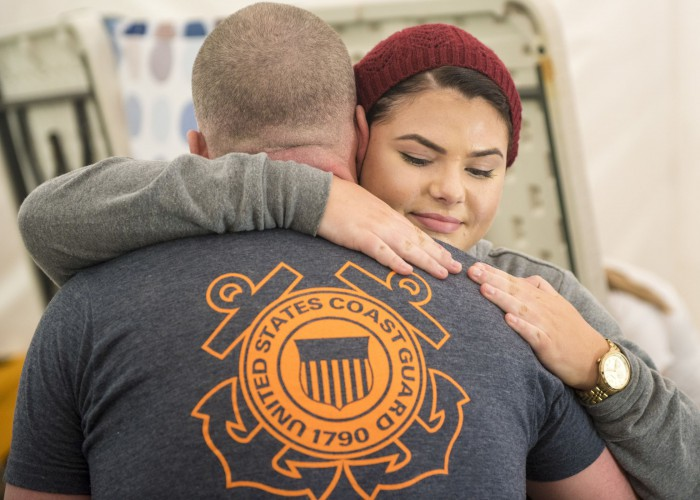 Madison Scaff hugs her father, Lt. Shannon Scaff, after he finished his goal of swimming 24 hours in a pool to memorialize the fallen aircrew of Coast Guard helicopter 6535 in Charleston, S.C., Feb. 28, 2015. Scaff trained for over a year to help prepare him for this test of endurance and will. U.S. Coast Guard photo by Petty Officer 1st Class Stephen Lehmann.