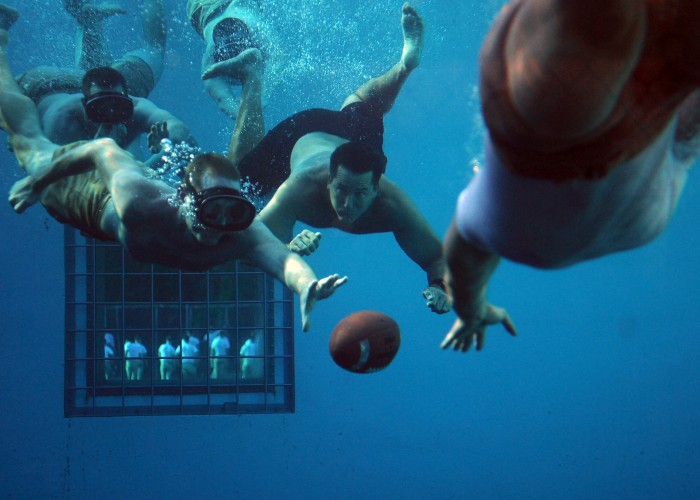 110603-N-AD372-308 PANAMA CITY, Fla. (June 3, 2011) Students at the Naval Diving and Salvage Training Center play underwater football to cool down after physical training. (U.S. Navy photo by Mass Communication Specialist Abraham Essenmacher/Released)