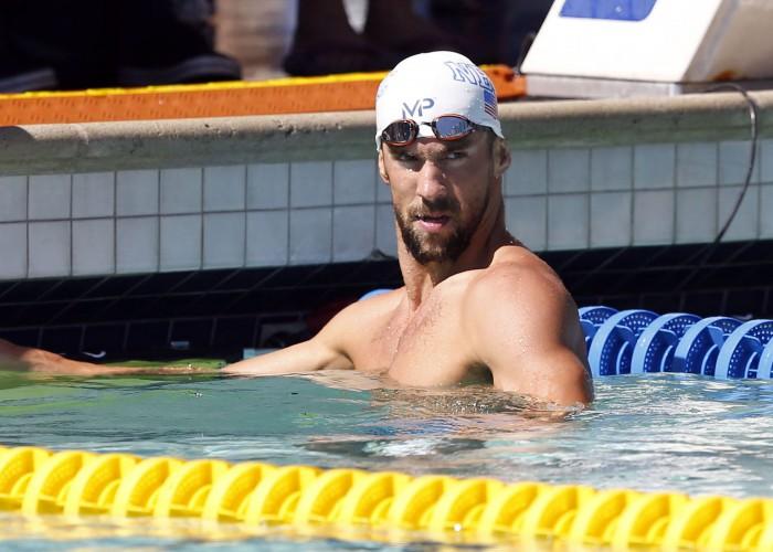 Jun 18, 2015; Santa Clara, CA, USA; Michael Phelps (USA) at the finish of his Men's 200M Freestyle morning prelim heat during day two of the Arena Pro Series at Santa Clara at the George F. Haines International Swim Center. Mandatory Credit: Bob Stanton-USA TODAY Sports