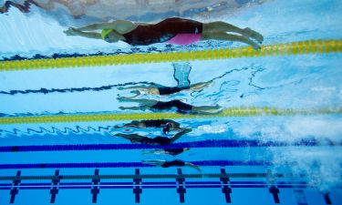 Jul 18, 2015; Toronto, Ontario, CAN; Joanna Maranhao of Brazil (top) dives in at the start of the women's swimming 200m individual medley preliminary heats during the 2015 Pan Am Games at Pan Am Aquatics UTS Centre and Field House. Mandatory Credit: Erich Schlegel-USA TODAY Sports