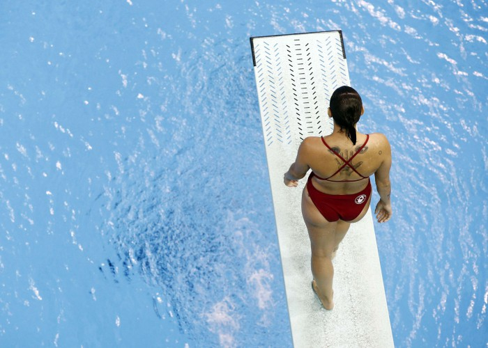 Jul 13, 2015; Toronto, Ontario, USA; Pamela Ware of Canada prepares for a dive in the women's synchronised diving 3m springboard final the 2015 Pan Am Games at Pan Am Aquatics UTS Centre and Field House. Mandatory Credit: Rob Schumacher-USA TODAY Sports