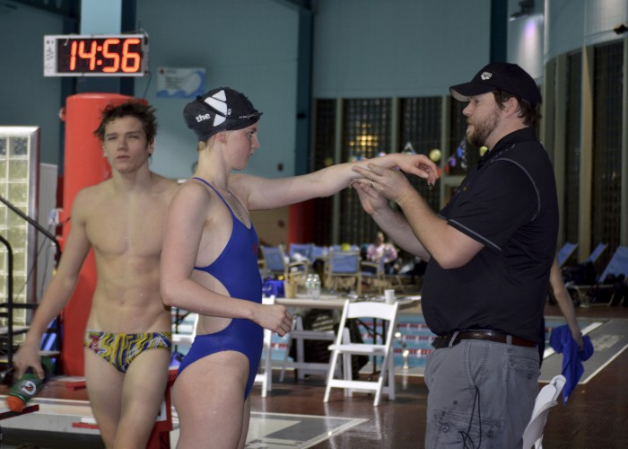 coach-helping-swimmer-stretch-shoulder-2016-cerave-invite