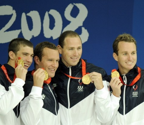 US swimmers Michael Phelps (L), Brendan Hansen (2nd L), Jason Lezak (2nd R) and Aaron Peirsol (R) pose with their medals on the podium for the men's 4 x 100m medley relay swimming final medal ceremony at the National Aquatics Center during the 2008 Beijing Olympic Games in Beijing on August 17, 2008. Michael Phelps became the first man to win eight gold medals at the same Olympics when the US won the men's 4x100m medley relay final in a new world record time. AFP PHOTO / DDP / AXEL SCHMIDT (Photo credit should read AXEL SCHMIDT/AFP/Getty Images)