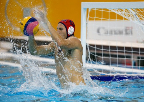 United States goalkeeper McQuin Baron blocks a shot by Ecuador during a water polo match at the Pan Am Games in Markham, Ontario, Tuesday, July 7, 2015. (AP Photo/Julio Cortez)