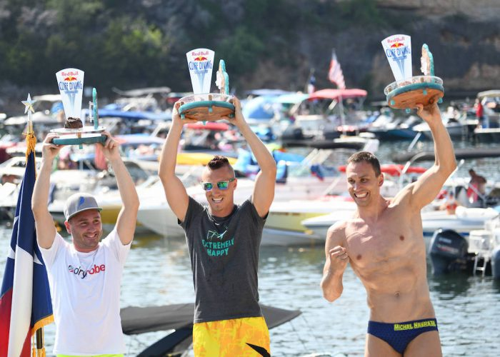 Blake Aldridge (L) of the UK, Kris Kolanus (C) of Poland and Michal Navratil of the Czech Republic celebrate on the podium during the final competition day of the first stop at the Red Bull Cliff Diving World Series in Possum Kingdom Lake, Texas, USA on June 2, 2018. // Romina Amato/Red Bull Content Pool // AP-1VUX71C692111 // Usage for editorial use only // Please go to www.redbullcontentpool.com for further information. //