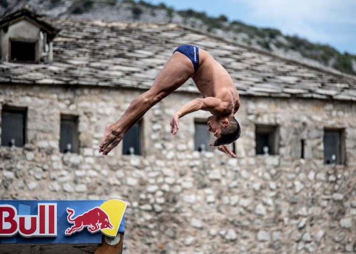 Jonathan Paredes of Mexico dives from the 27 metre platform on Stari Most during the first competition day of the sixth stop at the Red Bull Cliff Diving World Series in Mostar, Bosnia and Herzegovina on September 7, 2018. // Dean Treml/Red Bull Content Pool // AP-1WTZX9VDH2111 // Usage for editorial use only // Please go to www.redbullcontentpool.com for further information. //