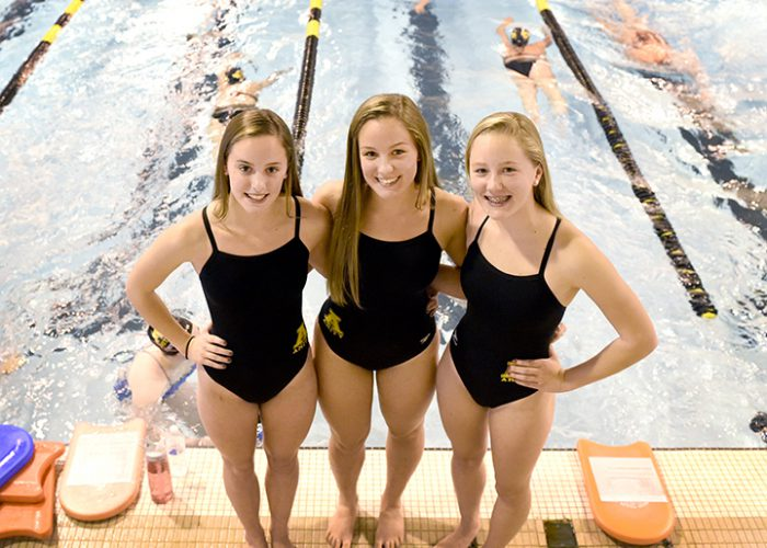 (Photo by Peter Hvizdak - New Haven Register) Sisters Megan Lasto, Mollee Lasto and Maggie Lasto, left to right, of the Amity High School swimming team Friday, October 10, 2014.