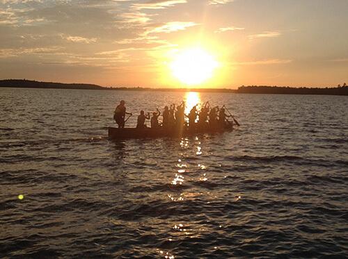 Camp Chikopi Boats at sunset