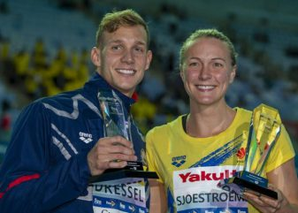 Caeleb Dressel (L) of the United States of America (USA) and Sarah Sjoestroem of Sweden pose with the trophy for the best male and female swimmer at the Swimming events at the Gwangju 2019 FINA World Championships, Gwangju, South Korea, 28 July 2019.