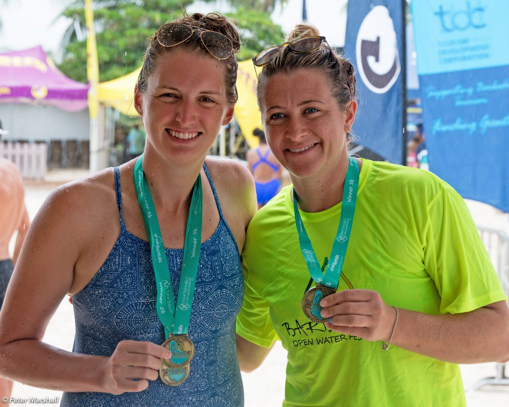 swim-barbados-open-water-festival-women-show-off-medals