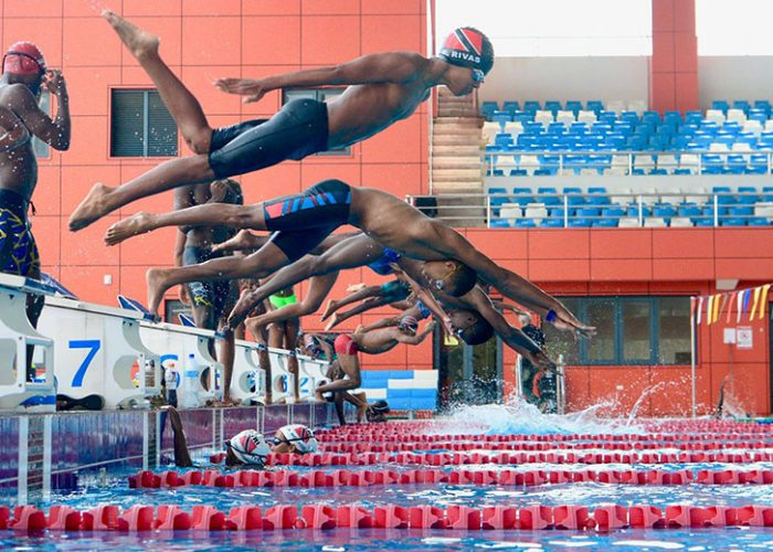 Giovanni going off the block at a swim meet