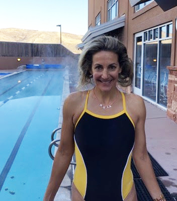 Summer in the same Dolfin swimsuit presently