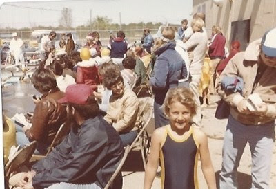 Summer in her Dolfin Swimwear suit at a swim meet at the age of 7