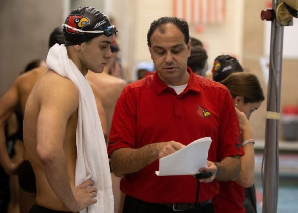 Head Coach Authur Albiero talks with Nicolas Albiero during match against Xavier at Ralph Wright Natatorium on October 6