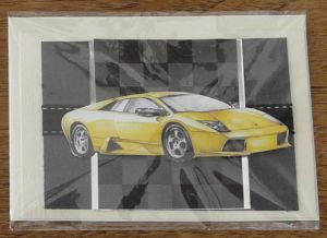 Card featuring raised picture of powerful yellow sports car.