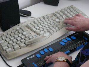 Conventional and Braille computer keyboards