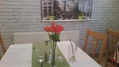 Roses in vase on table