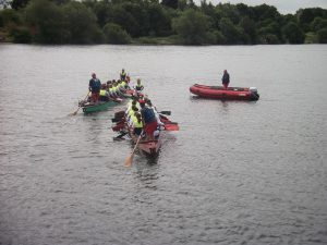 2 dragon boats and a dinghy
