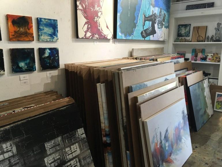 Stacks of paintings in Art One Gallery - Scottsdale, Arizona.