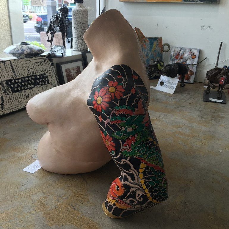 Sculpture of a nude body with traditional Japanese tattoos at Art One Gallery in Old Town Scottsdale, Arizona.