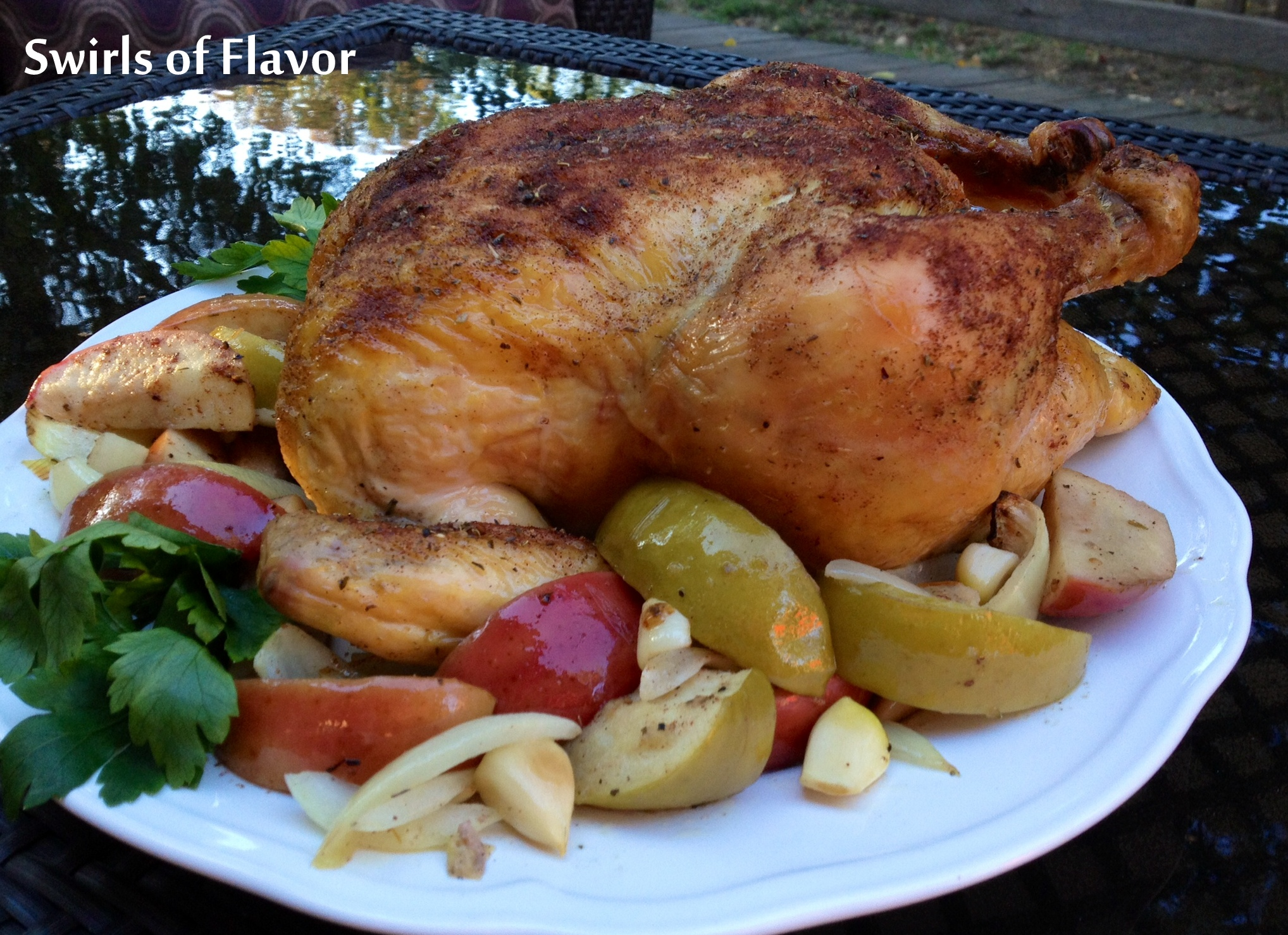 Roasted Cinnamon Apples N Chicken is an easy recipe of melt-in-your-mouth buttery apples, savory onions, tender sweet cloves of roasted garlicand chicken seasoned with the warm spices of autumn. A delicious comfort food for fall! #chicken #apples #roastedchicken #comfortfood 3sundaysupper #fallrecipe #easyrecipe #cinnamon #redapples #grannysmithapples #swirlsofflavor