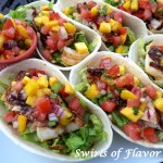 It's Taco Tuesday! Season and grill your favorite fish, top with a fresh Mango Pico De Gallo and your Fish Tacos With Mango Pico De Gallo will be bursting with tropical flavors! #fish #fishtacos #mango #picodegallo #homemade #tacotuesday #easyrecipe #dinner #swirlsofflavor